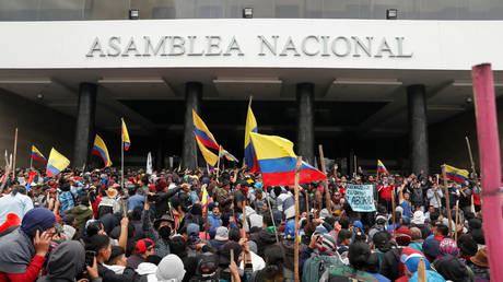 Demonstrators gather outside Ecuador's parliament building in Quito during heated protests over austerity measures, October 8, 2019.