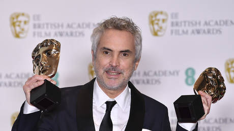 "Director Alfonso Cuaron won 2 BAFTAs this year for ""Roma,"" a film about an underrepresented group © AFP / Ben STANSALL"