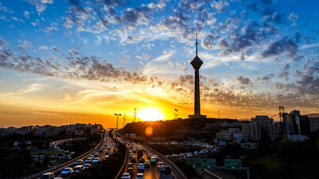 Milad Tower and street at sunset, Tehran, Iran