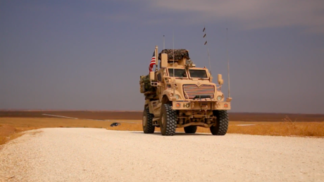 US military vehicles moving near the Syrian village of Tell Brak on October 21