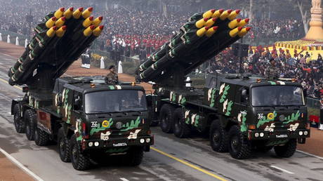 Indian army officers stand on vehicles displaying missiles during the Republic Day parade in New Delhi
