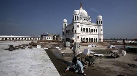 Laborers are seen working on the site around Guru Nanak's tomb in Kartarpur, Pakistan on September 16, 2019.