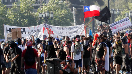 Demonstrators gather during a protest in Santiago, Chile, October 24, 2019.