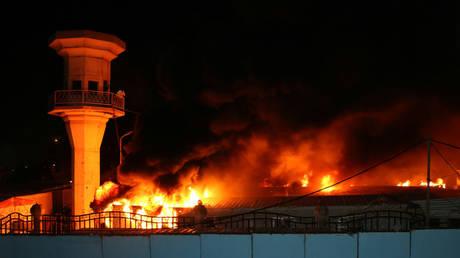 The Diwaniya Provincial Council Building is seen burning on October 25, 2019. © REUTERS/Imad al-Khozai