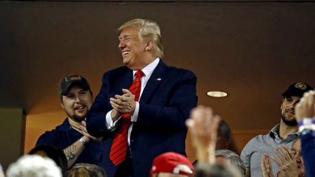 US President Donald Trump waves to the crowd during game five of the 2019 World Series between the Houston Astros and the Washington Nationals at Nationals Park.  © Reuters / USA TODAY / Geoff Burke