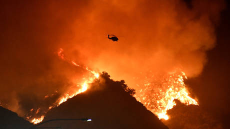 A helicopter flies over the Getty Fire west of Los Angeles, California, October 28, 2019.