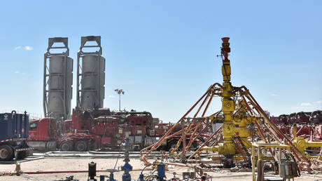 A wellhead on a fracking site leased by Oasis Petroleum is seen in the Permian Basin oil production area near Wink, Texas, US