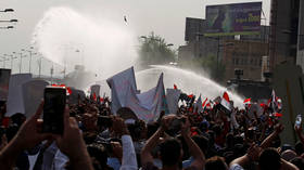 Gunshots, tear gas & water cannons: Clashes between protesters and police erupt in Baghdad, several people injured (VIDEO, PHOTOS)