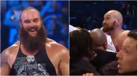 'You dosser!' Tyson Fury jumps barricade in shock WWE appearance to confront Braun Strowman (VIDEO)