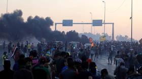 Saudi, Kurdish TV channels stormed by GUNMEN in Iraq's Baghdad amid mass unrest