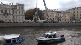 We need a bigger crane! WATCH runaway truck crane plunge into river in St. Petersburg (CCTV VIDEO)