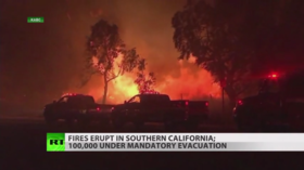 Thousands evacuate as wildfires engulf California