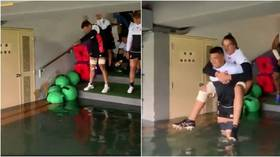 Rugby World Cup stars forced to 'swim' to training in typhoon-hit Japan (VIDEO)
