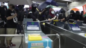 Masked Hong Kong protesters SMASH UP metro station with metal bars and hammers in defiance of emergency order (VIDEO)