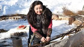 Russian shaman aims to capture REALLY BIG evil spirits (and a record) as she crafts dreamcatcher the size of Soviet block (VIDEO)