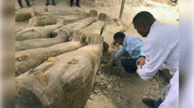 Vast trove of sarcophagi found 'as the ancient Egyptians left them' in Luxor (PHOTOS)
