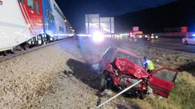 WATCH highway patrol trooper pull unconscious man from car SECONDS before train crash in Utah