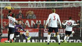 Liverpool snatch late draw at Manchester Utd but Klopp's men see record bid end