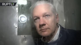 WATCH: Rare glimpse of Julian Assange INSIDE prison van