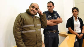 'Longest trial in history': Palestinian aid worker charged with funding Hamas attends 129th hearing