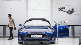 Tesla driver burned to death because first responders couldn't open doors, lawsuit claims