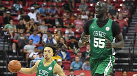 A low blow: Celtics rookie discovers there's a down side to being NBA's tallest player after low ceiling leaves him concussed