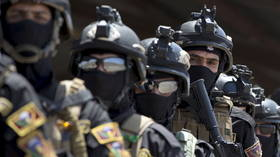 Iraq deploys elite counter-terrorism unit to protect state buildings as chaotic protests rock Baghdad