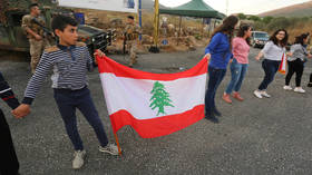 Lebanon protesters block roads, defy pleas from top leaders