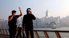 Hong Kong shares slip after Moody's downgrade over ongoing protests