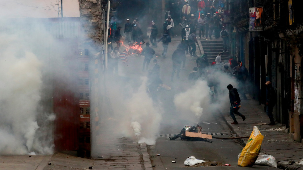 WATCH Morales supporters tear-gassed in clashes with riot police as Bolivians protest unelected 'interim president'