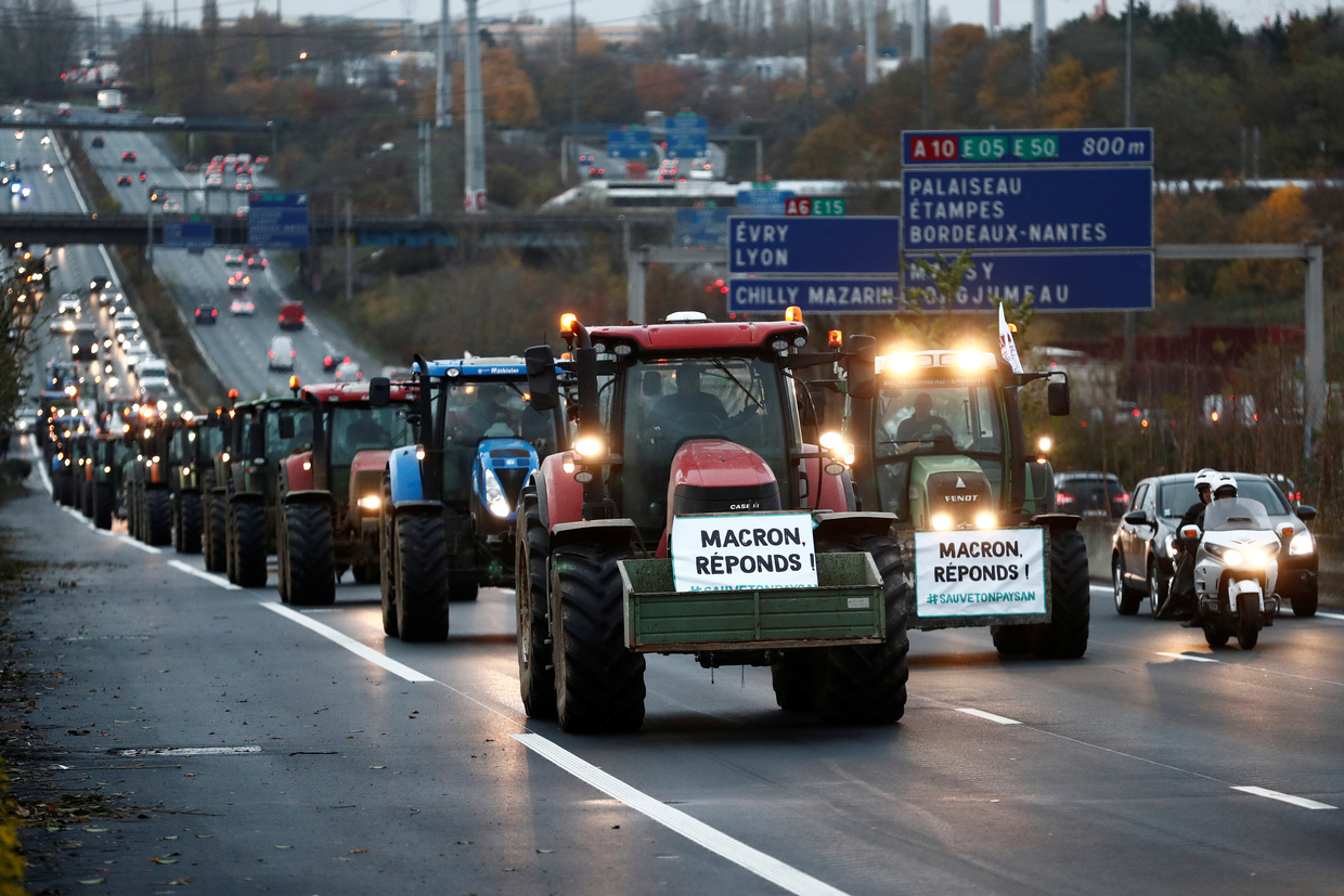 French tractors roll into Paris to protest against 'agri-bashing'