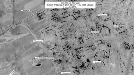 A satellite photo dated Sept. 8, that shows nearly three dozen oil trucks near the occupied oil fields in Deir ez-Zor, Syria