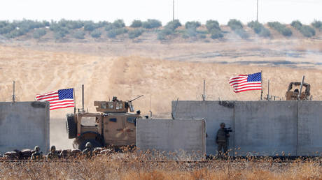 FILE PHOTO: US troops seen behind Turkish border walls during a joint US-Turkey patrol in northern Syria © Reuters / Murad Sezer