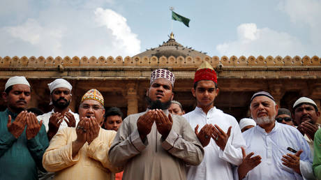 Muslims pray for peace ahead of verdict on a disputed religious site in Ayodhya