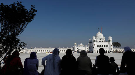 Indian Sikh pilgrims are solhouetted as they visit the Gurdwara Darbar Sahib in Kartarpur, Pakistan November 9, 2019.