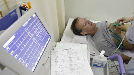 FILE PHOTO: A patient undergoes an electrocardiogram (ECG) test at Juntendo University Hospital in Tokyo, Japan.
