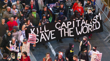FILE PHOTO: Members of the Occupy Wall Street movement march down Broadway during a May Day demonstration in New York, May 1, 2012