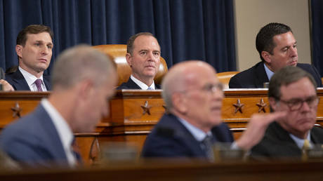 United States Representative Adam Schiff (Democrat of California) listens to the testimony of Deputy Assistant U.S. Secretary of State George Kent and Acting U.S. Ambassador to Ukraine William Taylor before the U.S. House Permanent Select Committee on Intelligence, November 13, 2019