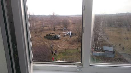 Flying way under the radar: MILITARY DRONE crashes in a backyard in a tiny Russian town (PHOTO, VIDEO)