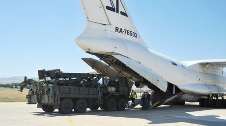 FILE PHOTO. Parts of a Russian S-400 defense system are unloaded from a Russian plane in Turkey. ©Turkish Defence Ministry via REUTERS