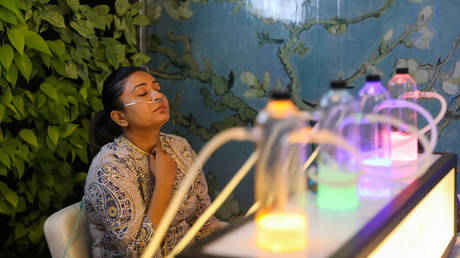 A customer inhales oxygen mixed with aromatherapy at an oxygen bar in New Delhi, India, November 15, 2019.
