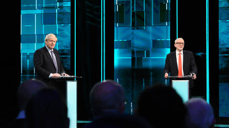 Conservative Prime Minister Boris Johnson (L) and Britain's Labour Party leader Jeremy Corbyn on the set of