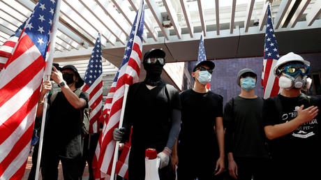 Anti-government protesters hold US flags during a rally at the University of Hong Kong, China, September 20, 2019