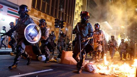 FILE PHOTO: Hong Kong police pass a burning barricade, November 2, 2019