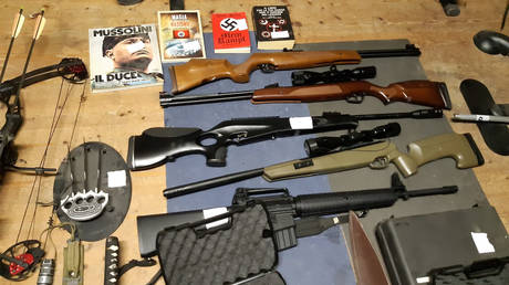 Weapons seized in police raids on a far right group that planned to create a new Nazi party, in an unidentified location in Italy, November 28, 2019.