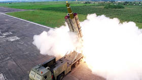 North Korea confirms firing 'super-large multiple rocket launchers'