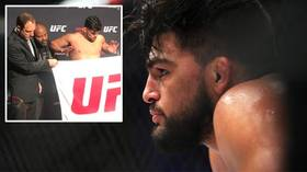 Lean on me: Kelvin Gastelum makes weight for UFC 244, but appears to LEAN on coach to hit his mark (VIDEO)