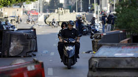 Protesters block roads in Lebanon on Monday, paralyzing traffic in the capital and on major highways
