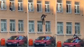 Houdini trick, but Russia-style? VIDEO shows 'suspect' jumping out of police station still handcuffed to RADIATOR