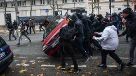 'Morons, bullies & thugs': French interior minister hits back at 'ultras' at Yellow Vests after Saturday mayhem in Paris